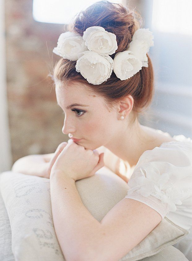 cute-topknot-bun-wedding-hairstyle-with-chiffon-flowers
