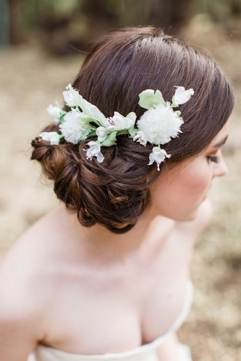 low-updo-wedding-hairstyle-with-white-elodie-flower-comb